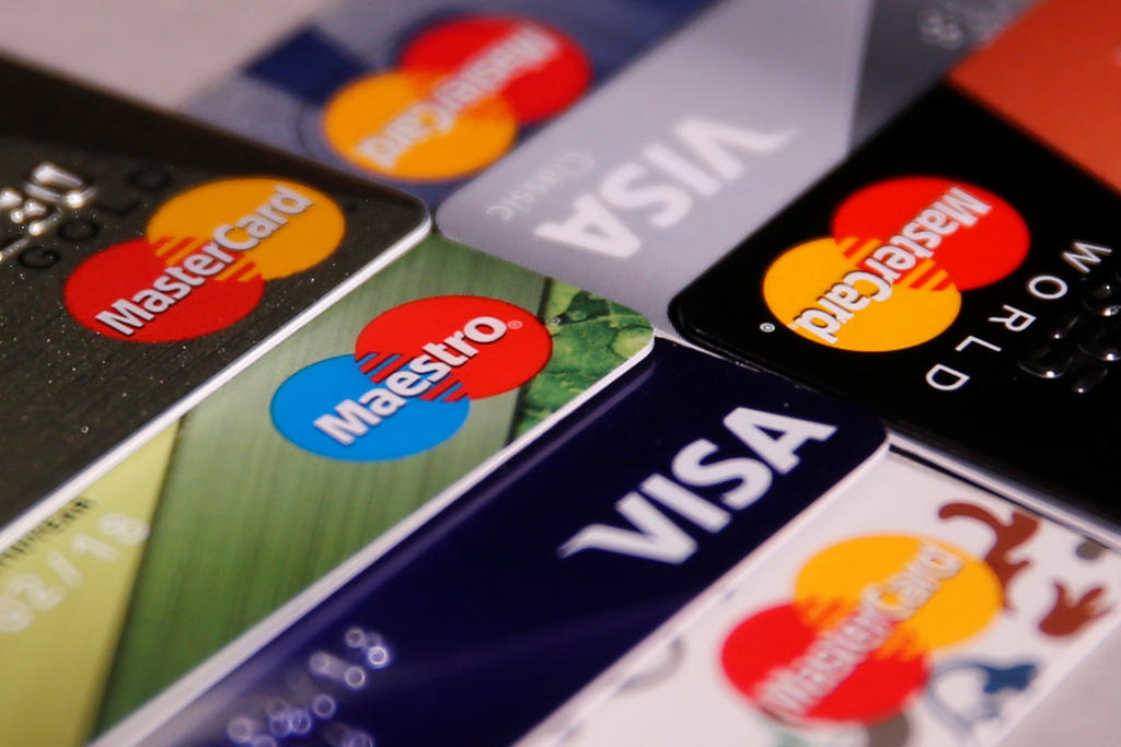 MasterCard, VISA and Maestro credit cards are seen in this picture illustration taken June 9, 2016. This Mastercard logo has been updated and is no longer in use.  REUTERS/Maxim Zmeyev/Illustration