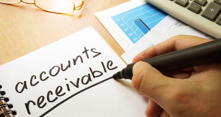 Accounts receivable written by hand in a note.