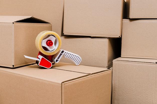 tape-dispenser-closed-cardboard-boxes_23-2148095549